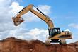 excavator with raised bucket