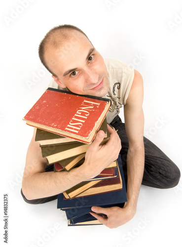 Happy young man with books
