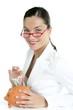 Beautiful businesswoman with piggybank  over white