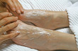 REFLEXOLOGY - applying cream prior to treatment