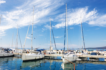 white yachts lined up at the marina in Baska Voda, Croatia