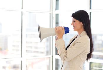 Businesswoman shouting through megaphone