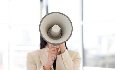 Portrait of a businesswoman shouting through megaphone