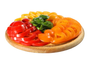 Red yellow orange green pepper on a chopping board