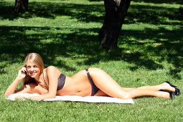 beautiful girl sunbathes in park