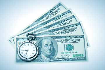 Time and money concept image - pocket watch and US currency isol