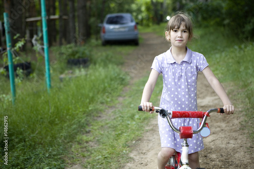 little cute girl  at bicycle