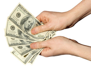 Money in a hand on a white background