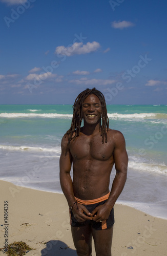 smiling man on the beach in cuba