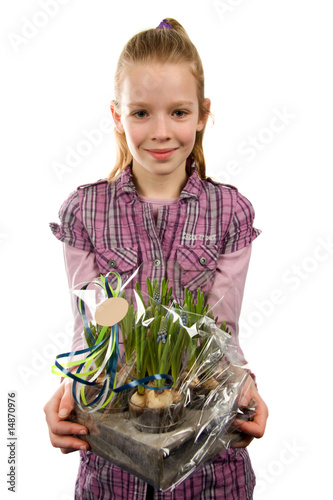 Young blonde girl with Muscari botryoides