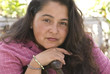 sitting hispanic woman