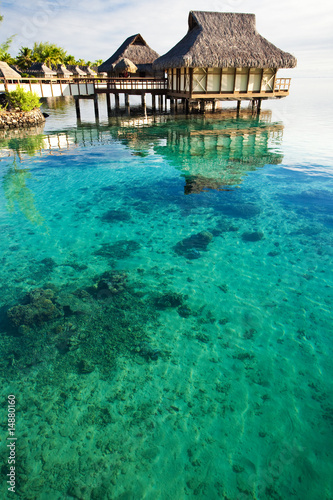 Over water bungalows over amazing coral lagoon