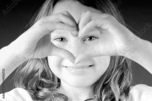 Girl making heart