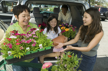 Family Loading New flowers into SUV