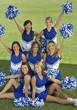 Cheerleaders posing on lawn, portrait