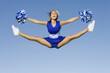 Smiling Cheerleader jumping in mid-air, portrait
