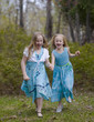 Sisters Running in Spring Dresses