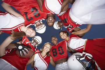 Football Players and cheerleaders in Huddle, view from below, view from below