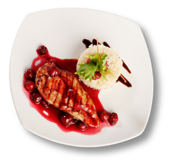 Delicious beef with cherry sauce. File includes clipping path fo