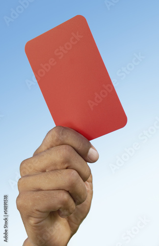 Soccer referee holding up red card, close-up on hand