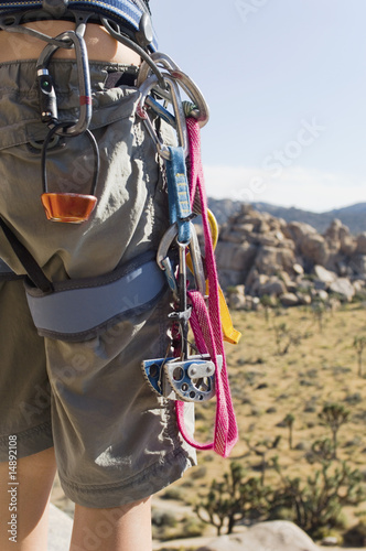 Climber with Carabineers Around Waist, mid section, back view