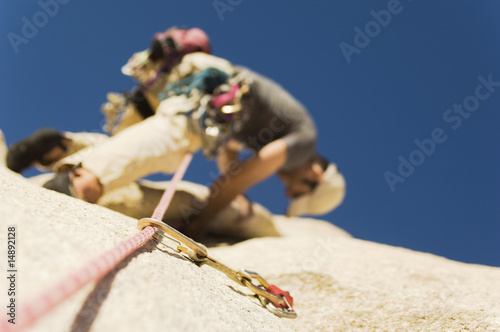 Man Climbing on Cliff, view from below, low angle view