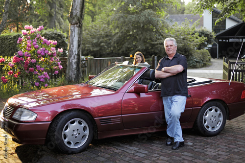 Old man in fronf of his cabriolet
