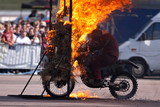 Stunt rider and wall of flames