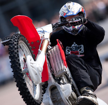 Stunt Rider pulling a wheelie