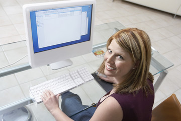 Woman sitting at computer, elevated view