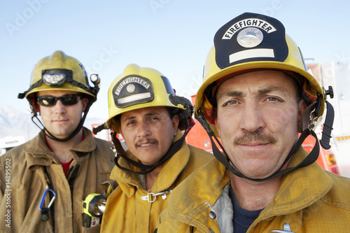 Three fire fighters, portrait