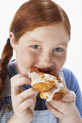 Overweight girl 13-15 Eating pastry, portrait, close-up
