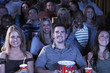 People holding soda and popcorn, Watching Movie in Theatre