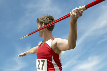 Athlete about to throw javelin, half length