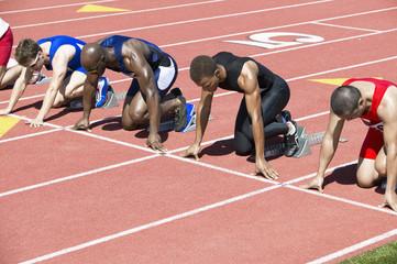 Runners Waiting in Starting Blocks