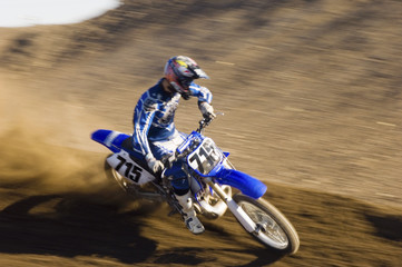 Motocross racer on dirt track