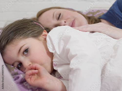 Mother Cuddling With Daughter
