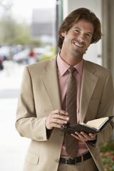 Businessman Using Organizer