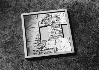 Slide-puzzle with jumbled map, b&w