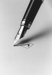 Tip of fountain pen marking checkbox, b&w, close-up