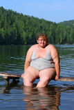 overweight woman sitting on stage poster