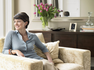 Smiling woman relaxing in living room
