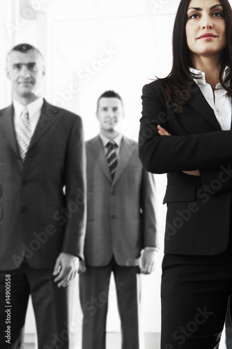 Businesswoman with Businessmen in Background