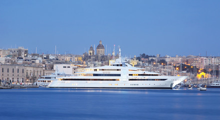 super yacht in a marina