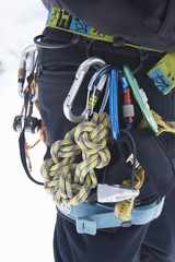 Hiker's belt filled with safety ropes, mid section