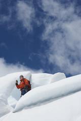 Hiker standing on ice chunks