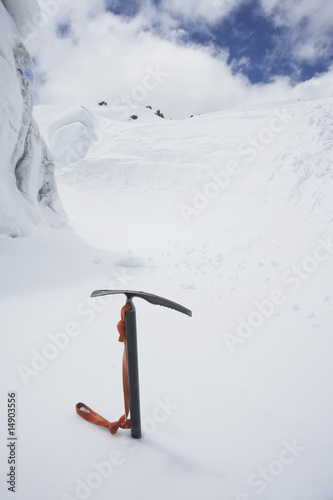 Mountain climbing pick axe in the snow
