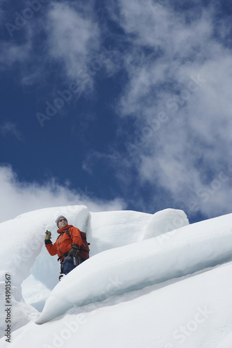 Hiker standing on ice chunks