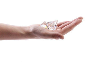 Hand holding two crystals