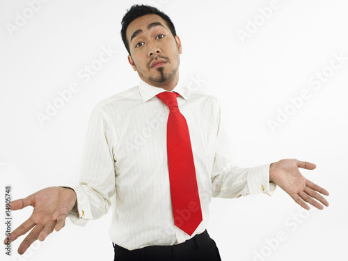 Man shrugging in studio, half-length